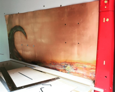 installing-copper-backsplash-in-camper-van-IG