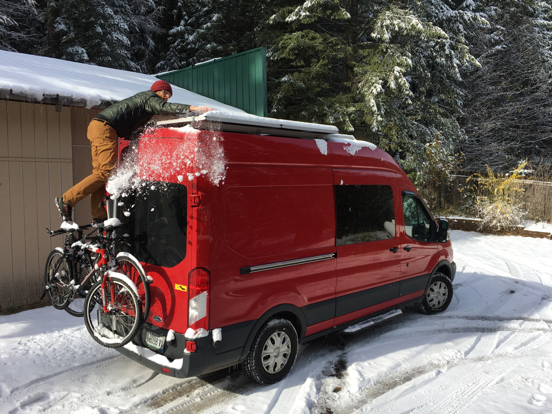 ford-transit-clearing-snow-off-solar-panels